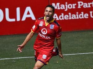 Adelaide strike late to beat 10-man Sydney