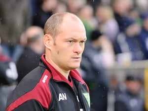 Alex Neil Manager of Norwich City looks on prior to the Barclays Premier League match between Norwich City and Everton at Carrow Road on December 12, 2015