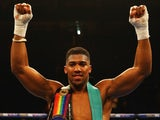Anthony Joshua celebrates after defeating Dillian Whyte by ko on December 12, 2015