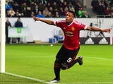 Manchester United's French striker Anthony Martial reacts after scoring the opening goal during the UEFA Champions League Group B second-leg football match VfL Wolfsburg vs Manchester United in Wolfsburg, central Germany, on December 8, 2015.