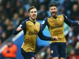 Aaron Ramsey of Arsenal celebrates as he scores their second goal past Brad Guzan of Aston Villa (1) during the Barclays Premier League match between Aston Villa and Arsenal at Villa Park on December 13, 2015 in Birmingham, England.