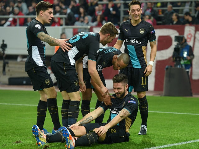 Olivier Giroud of Arsenal celebrates with his team-mates after scoring the second goal for Arsenal during the UEFA Champions League Group F match between Olympiacos FC and Arsenal FC at Karaiskakis Stadium on December 9, 2015 in Piraeus, Greece.