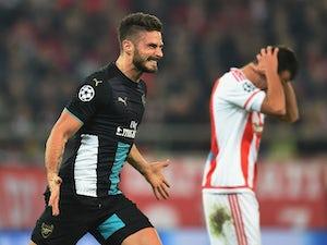 Giroud hat-trick sees Arsenal progress