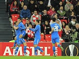 Alkmaar's midfielder Joris van Overeem (2ndL) celebrates with (FromL) midfielder Ben Rienstra, forward Vincent Janssen and midfielder Thom Haye after scoring during the UEFA Europa League football match Athletic Club Bilbao vs AZ Alkmaar at the San Mames