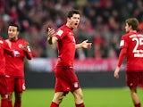 Bayern Munich's Polish striker Robert Lewandowski (C) celebrates scoring during the German first division Bundesliga football match FC Bayern Munich vs FC Ingolstadt 04 in Munich, southern Germany, on December 12, 2015