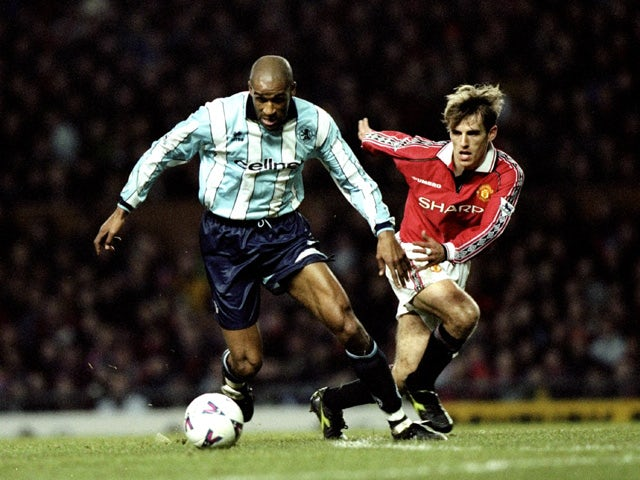Brian Deane of Middlesbrough holds off the challenge from Philip Neville of Manchester United during the FA Carling Premiership match against Manchester United played at Old Trafford in Manchester, England