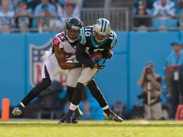 Robert Alford #23 of the Atlanta Falcons tackles Corey Brown #10 of the Carolina Panthers in the 1st quarter during their game at Bank of America Stadium on December 13, 2015