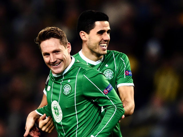 Celtic's Kris Commons (L) celebrates with his teammate Tom Rogic (R) after scoring during the UEFA Europa League football match between Fenerbahce and Celtic at Fenerbahce Sukru Saracoglu stadium in Istanbul on December 10, 2015