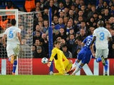 The ball rebounds off Porto's Spanish goalkeeper Iker Casillas (3R) as he saves a shot from Chelsea's Brazilian-born Spanish striker Diego Costa (2R) to hit Porto's Spanish defender Ivan Marcano (L) and ricochet into the goal for an own goal during the UE