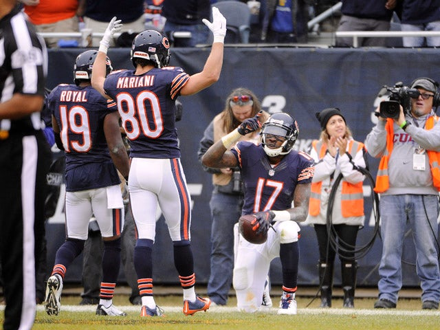 Alshon Jeffery #17 celebrates a touchdown with Eddie Royal #19 and Marc Mariani #80 of the Chicago Bears during the second quarter against the Washington Redskins on December 13, 2015