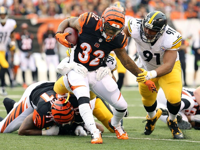Stephon Tuitt #91 of the Pittsburgh Steelers tackles Jeremy Hill #32 of the Cincinnati Bengals during the first quarter at Paul Brown Stadium on December 13, 2015