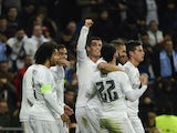 Real Madrid's Portuguese forward Cristiano Ronaldo (C) celebrates with teammates after scoring his fourth goal during the UEFA Champions League Group A football match Real Madrid CF vs Malmo FF at the Santiago Bernabeu stadium in Madrid on December 8, 201