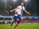 Scott Dann of Crystal Palace celebrates scoring the opening goal during the Barclays Premier League match between Everton and Crystal Palace at Goodison Park on December 7, 2015