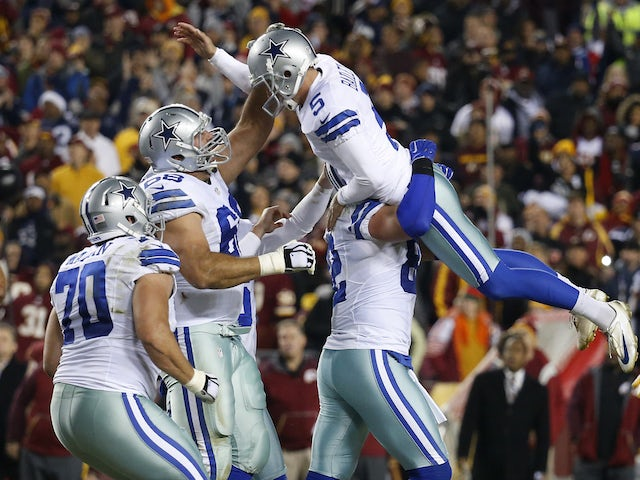 Tight end Jason Witten #82 of the Dallas Cowboys lifts up Dan Bailey #5 after Bailey kicked the game-winning field goal with seconds remaining to defeat the Washington Redskins 19-16 at FedExField on December 7, 2015 in Landover, Maryland.