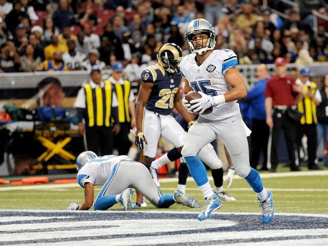 Golden Tate #15 of the Detroit Lions scores a touchdown in the fourth quarter against the St. Louis Rams at the Edward Jones Dome on December 13, 2015