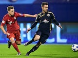 Bayern Munich's midfielder Joshua Kimmich (L) vies with Dinamo Zagreb's Portuguese defender Ivo Pinto during the UEFA Champions League football match between Dinamo Zagreb v Bayern Munich at the Maksimir stadium in Zagreb on December 9, 2015.