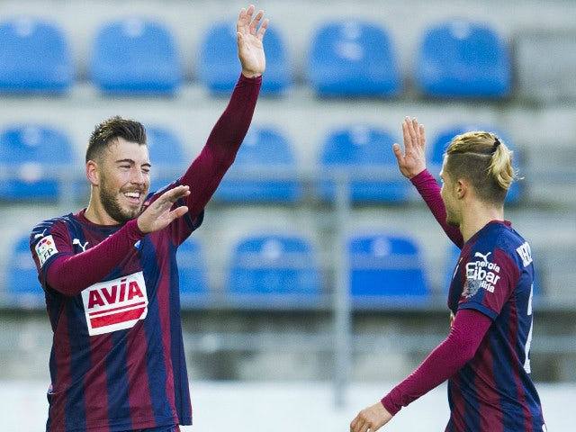 Sergi Enrich of SD Eibar celebrates with his teammate Sergio Gontan of SD Eibar after scoring the opening goal during the La Liga match between SD Eibar and Valencia CF at Ipurua Municipal Stadium on December 13, 2015 in Eibar, Spain.