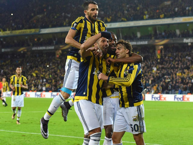 Fenerbahce's Lazar Markovic (R) celebrates with his teammates after scoring during the UEFA Europa League football match between Fenerbahce and Celtic at Fenerbahce Sukru Saracoglu stadium in Istanbul on December 10, 2015