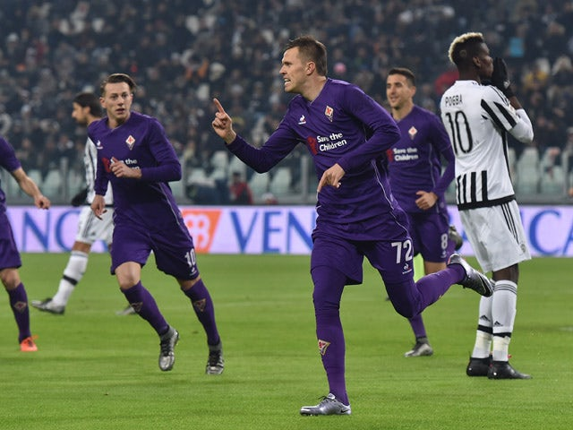 Josip Ilicic of ACF Fiorentina celebrates the opening goal from the penalty spot during the Serie A match betweeen Juventus FC and ACF Fiorentina at Juventus Arena on December 13, 2015