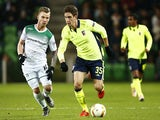 FC Groningen's Albert Rusnak vies with Sporting Braga's Nikola Vukcevic during the UEFA Europa League football match opposing Groningen to Sporting Braga on December 10, 2015