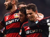 Leverkusen's Mexican striker Javier Hernandez (2nd R) and his teammates celebrate during the German first division Bundesliga football match Bayer 04 Leverkusen vs Borussia Moenchengladbach in Leverkusen, western Germany, on December 12, 2015. Leverkusen