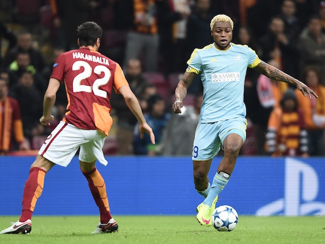 Astana's Congolese forward Junior Kabananga (R) and Galatasaray's Turkish defender Hakan Balta vie for the ball during the UEFA Champions League Group C football match between Galatasaray AS and FC Astana at the Turk Telekom Arena in Istanbul on December