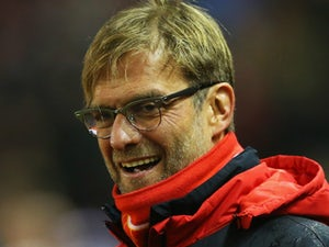 Jurgen Klopp manager of Liverpool looka on prior to the Barclays Premier League match between Liverpool and West Bromwich Albion at Anfield on December 13, 2015 in Liverpool, England.