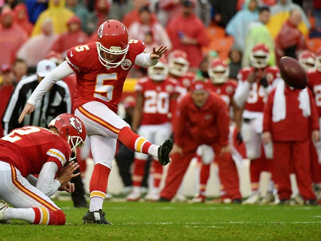 Cairo Santos #5 of the Kansas City Chiefs kicks a field goal from the hold of teammate Dustin Colquitt #2 at Arrowhead Stadium during the second quarter of the game against the San Diego Chargers on December 13, 2015