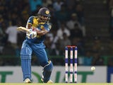 Sri Lankan cricketer Kusal Perera plays a shot during the first Twenty20 International cricket match between Sri Lanka and the West Indies at the Pallekele International Cricket Stadium in Pallekele on November 9, 2015