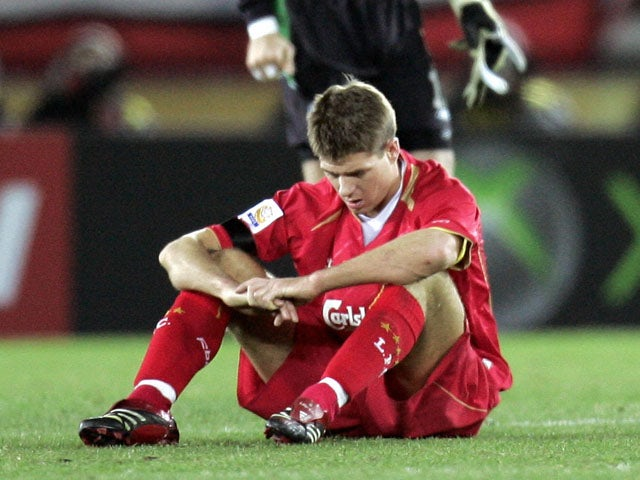 England's Liverpool FC captain Steven Garrard (lower) sits on the pitch after losing to South American champion Sao Paulo FC in the final match of the FIFA Club World Championship in Yokohama, 18 December 2005
