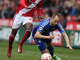Albert Adomah of Middlesbrough fouls Luke Varney of Ipswich Town during the Sky Bet Championship match between Middlesbrough and Ipswich Town at the Riverside Stadium on March 14, 2015