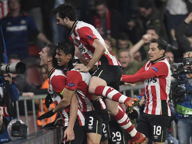 PSV Eindhoven's Dutch forward Luuk De Jong (L) celebrates with his teammates after scoring during the UEFA Champions League, Group B, football match PSV Eindhoven vs FK CSKA Moscow at the Philips Stadion stadium in Eindhoven on December 8, 2015.