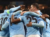 Manchester City players celebrate after Manchester City's English midfielder Raheem Sterling (R) scored his second and City's third goal to take the lead 3-2 during the UEFA Champions League Group D football match between Manchester City and Borussia Moen