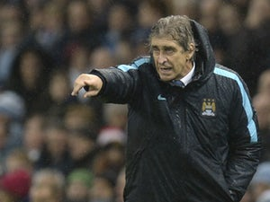 Manchester City's Chilean manager Manuel Pellegrini gestures from the touchline during the English Premier League football match between Manchester City and Swansea City at the Etihad Stadium in Manchester, north west England, on December 12, 2015