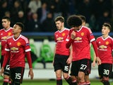 Manchester United's English midfielder Jesse Lingard (35), Manchester United's Belgian midfielder Marouane Fellaini (27) react after the UEFA Champions League Group B second-leg football match VfL Wolfsburg vs Manchester United in Wolfsburg, central Germa