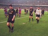 Dennis Irwin leads the Manchester United players off the field after they lost 4-0 to Barcelona on November 2, 1994