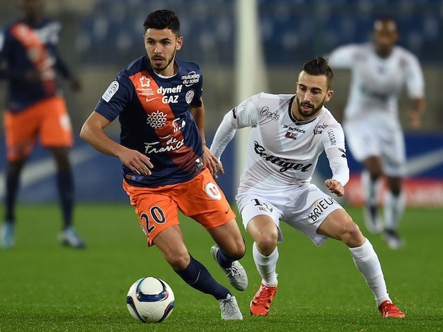 Montpellier's French midfielder Morgan Sanson (L) vies with Guingamp's French midfielder Nicolas Benezet during the French L1 football match between Montpellier and Guingamp, at the La Mosson Stadium in Montpellier, southern France, on December 12, 2015.