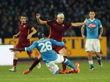 Kalidou Koulibaly (L) of Napoli competes for the ball with Edin Dzeko of Roma during the Serie A match betweeen SSC Napoli and AS Roma at Stadio San Paolo on December 13, 2015