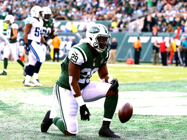 Bilal Powell #29 of the New York Jets celebrates scoring a touchdown in the second quarter against the Tennessee Titans during their game at MetLife Stadium on December 13, 2015