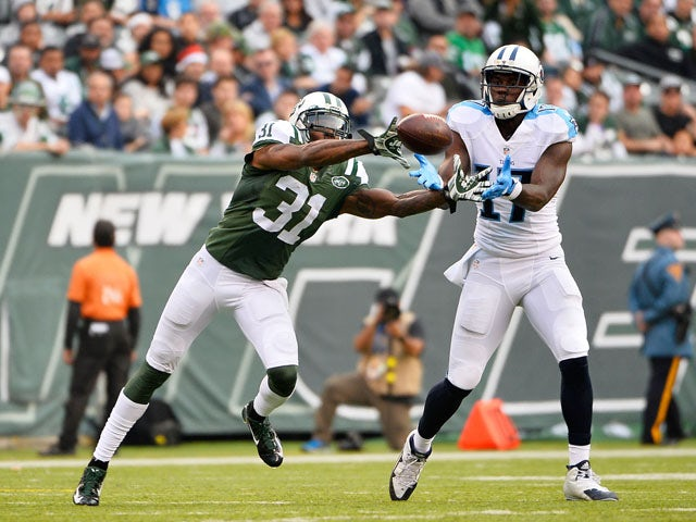 Antonio Cromartie #31 of the New York Jets breaks up a pass inended for Dorial Green-Beckham #17 of the Tennessee Titans in the third quarter during their game at MetLife Stadium on December 13, 2015