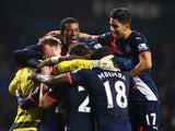 Newcastle United players celebrate victory after the Barclays Premier League match between Tottenham Hotspur and Newcastle United at White Hart Lane on December 13, 2015