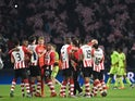 PSV Eindhoven's players celebrate after winning the UEFA Champions League, Group B, football match PSV Eindhoven vs FK CSKA Moscow at the Philips Stadion stadium in Eindhoven on December 8, 2015. PSV won the match 2-1.