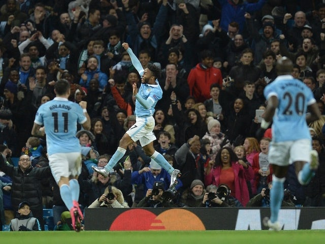 Manchester City's English midfielder Raheem Sterling (C) celebrates scoring his second and City's third goal to take the lead 3-2 during the UEFA Champions League Group D football match between Manchester City and Borussia Moenchengladbach at the Etihad S