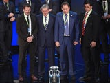 Representatives of teams drawn in group B (L-R) Slovakia's assistant coach Stefan Tarkovic, England's coach Roy Hodgson, Russia's coach Leonid Slutski and Wales' coach Chris Coleman pose with the trophy after the final draw of the UEFA Euro 2016 football
