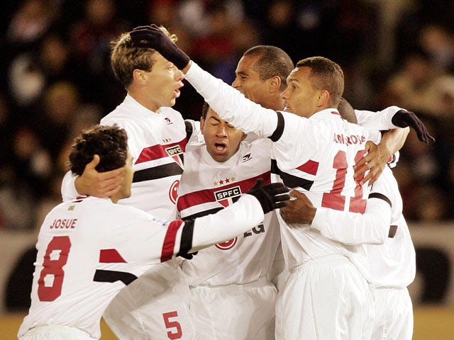Brazil's Sao Paulo FC midfielder team members celebrate after midfielder Mineiro (R) scored a goal during the final of the Toyota Cup FIFA Club World Championship against England's Liverpool FC at the Yokohama stadium 18 December 2005