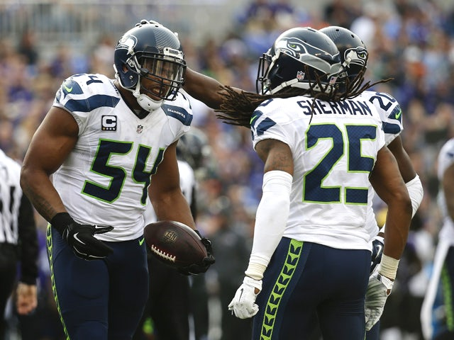 Middle linebacker Bobby Wagner #54 of the Seattle Seahawks celebrates with teammates cornerback Richard Sherman #25 and cornerback Jeremy Lane #20 after recovering a fumble against the Baltimore Ravens in the second quarter at M&T Bank Stadium on December