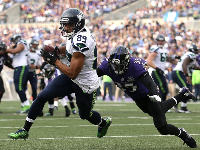 Wide receiver Doug Baldwin #89 of the Seattle Seahawks runs to score a second quarter touchdown past defensive back Shareece Wright #35 of the Baltimore Ravens at M&T Bank Stadium on December 13, 2015