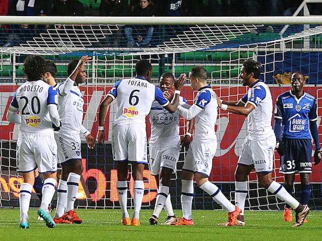 Bastia's players celebrate after Bastia's French midfielder Seko Fofana (C) scored a goal during the French L1 football match between Troyes and Bastia on December 12, 2015 at the Aube Stadium in Troyes.