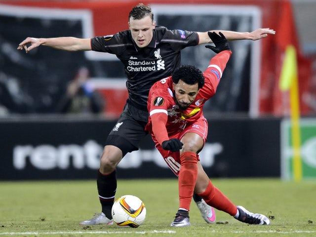 Liverpool's Australian defender Brad Smith (L) and Sion's Portugese midfielder Carlitos vie for the ball during the UEFA Europa League group B football match between FC Sion and FC Liverpool at the Tourbillon stadium in Sion on December 10, 2015