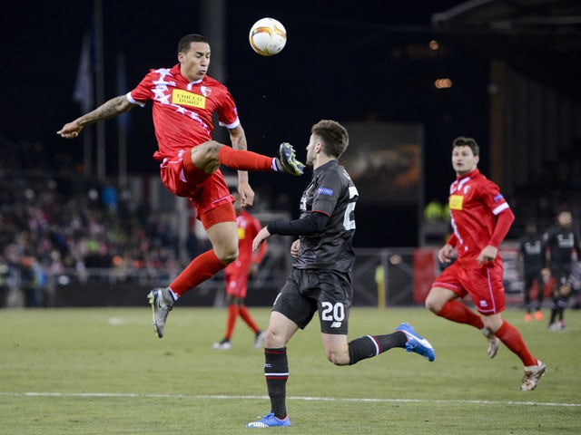 Sion's Swiss defender Leo Lacroix (L) and Liverpool's English midfielder Adam Lallana vie for the ball during the UEFA Europa League group B football match between FC Sion and FC Liverpool at the Tourbillon stadium in Sion on December 10, 2015